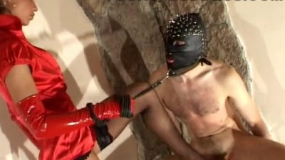 Shoes femdom ballbusting & kicking of a leather masked slave