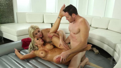 Busty milfs Cristi Ann and Nina Elle gives the guy best dick massage of his life