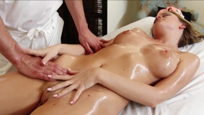 Alexis Adams has her oiled body massaged and fucked on the massage table