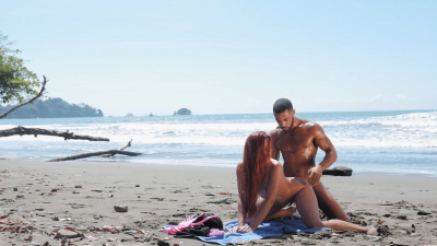 Red-headed Gala Brown moaning with pleasure during passionate sex on the beach